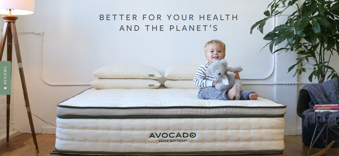 Photo of Avocado's organic mattress with baby sitting on top.