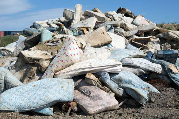 Photo of mattresses in landfill